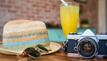 camera hat sunglasses
