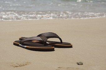 Mens sandals on a beach