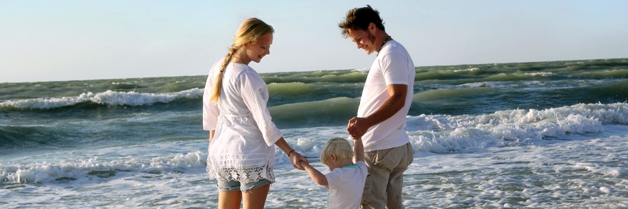 outer banks family in the surf